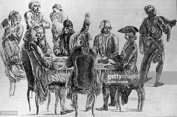 Circa 1750 French philosopher and writer Francois Marie Arouet better known as Voltaire at a dinner attended by fellow intellectuals d'Alembert...