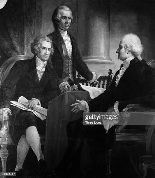 The 1st President of the United States, George Washington in consultation with members of his first cabinet; Secretary of State Thomas Jefferson ,...
