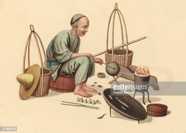 A Chinese man surrounded by the tools with which he repairs pots cauldrons and kettles
