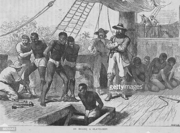 Enslaved people aboard a ship being shackled before being put in the hold. Illustration by Swain