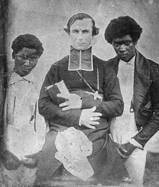 A missionary with two Tahitian converts.