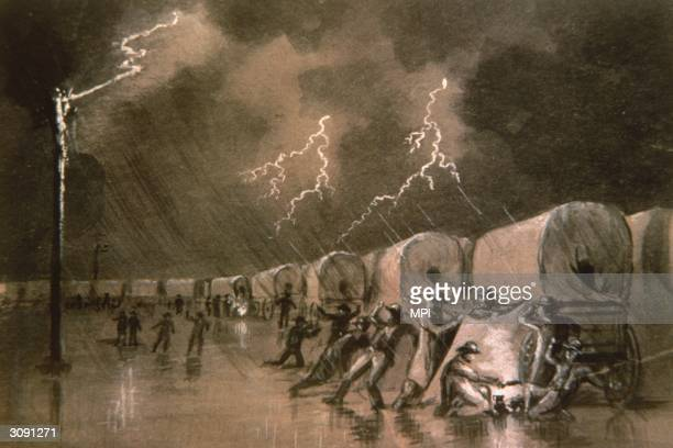 A tall pole acts as a lightning conductor protecting a group of wagon drivers during a storm A painting by W H Jackson