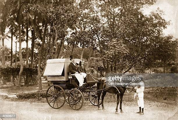 A family prepares to set off on a journey in their private coach