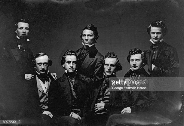 Studio portrait of a group of men in jackets vests and cravats The image is a 1/4 plate daguerreotype