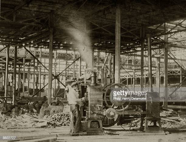 Steam engine near the Great Transept in Crystal Palace, during its reconstruction at Sydenham Hill, South London.