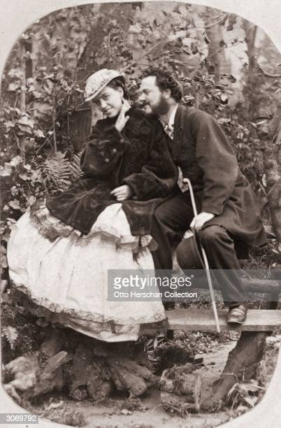 A young man whispers in his sweetheart's ear during a country walk