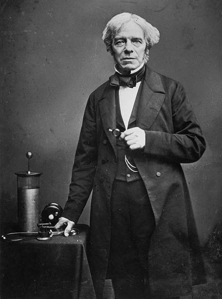 English scientist Michael Faraday with some of his...
