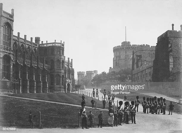 Grenadier Guardsmen in bearskin hats outside St George's Chapel Windsor Castle