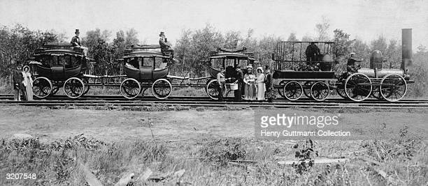 Passengers and employees standing by a train on the De Witt Clinton Railway Built in 1831 it was the first railway in the USA