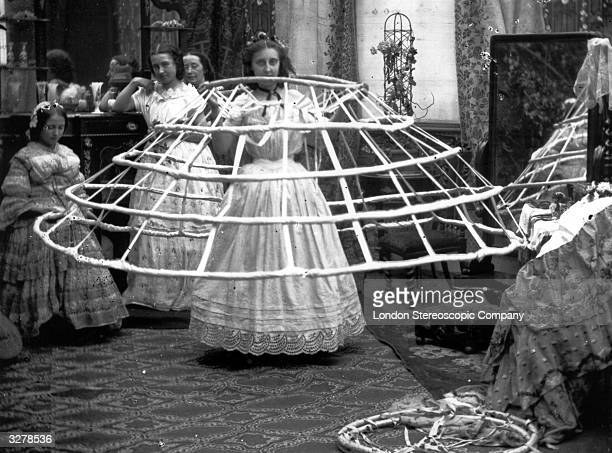 The scene from a ladies dressing room preparing for the crinoline London Stereoscopic Company Comic Series 503