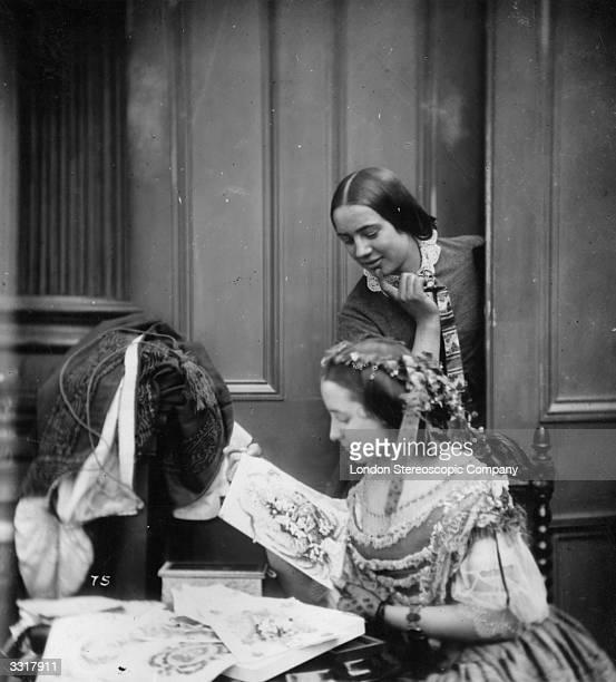 Two victorian women admiring Valentine cards in a domestic setting London Stereoscopic Company Comic Series 75