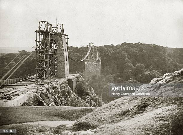 The partiallybuilt structure of the Clifton Suspension Bridge spanning the Avon Gorge in Bristol Designed by Isambard Kingdom Brunel the bridge was...