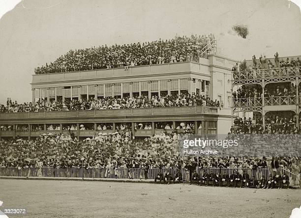 A crowd of racegoers on the grandstand at Ascot