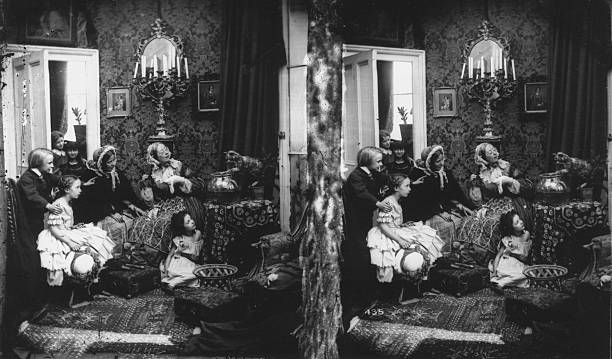 A Victorian family watching a cat play with a goldfish...