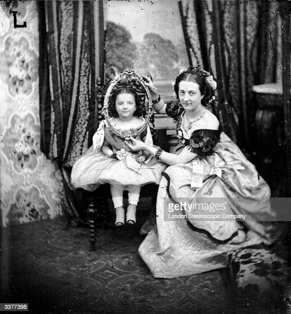 A woman holding a frame around a child's face for a photograph session London Stereoscopic Company Comic Series 123