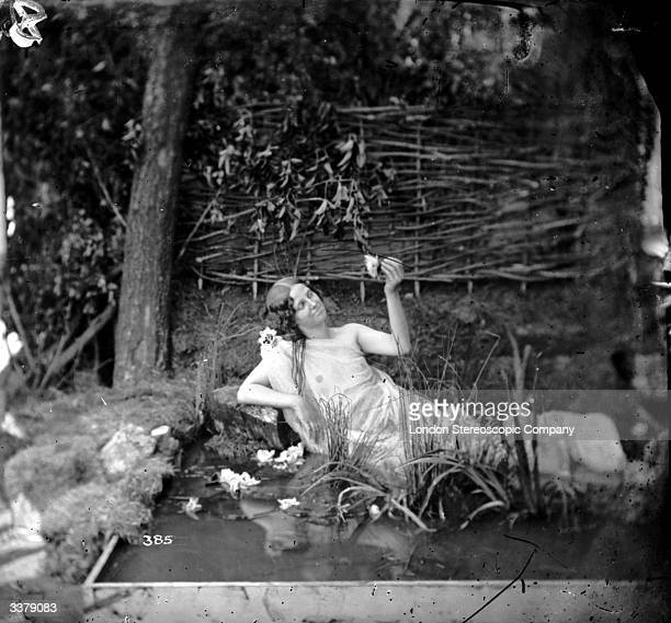A woman reclining in forest pool dressed as a nymph London Stereoscopic Company Comic Series 385