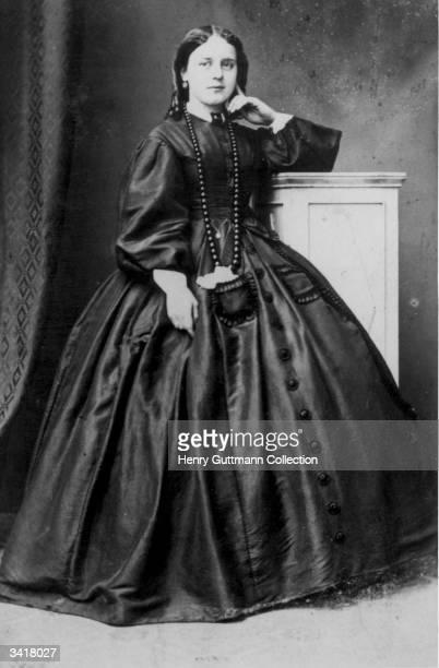 A woman wearing a full length crinoline dress