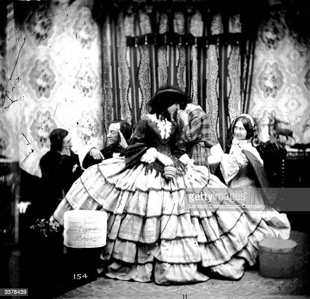 A woman wearing an exceptionally wide crinoline skirt London Stereoscopic Company Comic Series 154