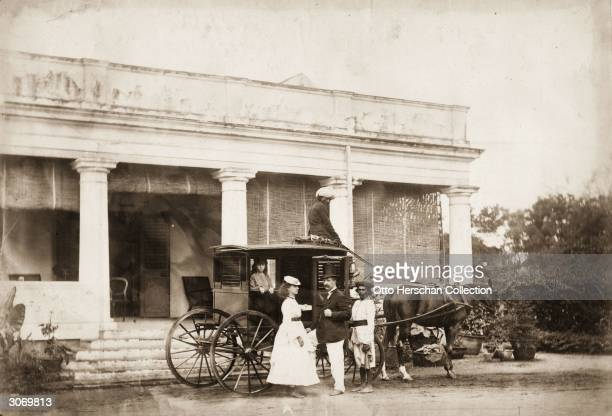 British General Augustus William Ritherdon boards a carriage in Madras with his daughter