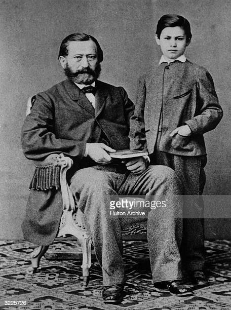 Studio portrait of Austrian psychoanalyst Dr. Sigmund Freud as a child, standing next to his father.