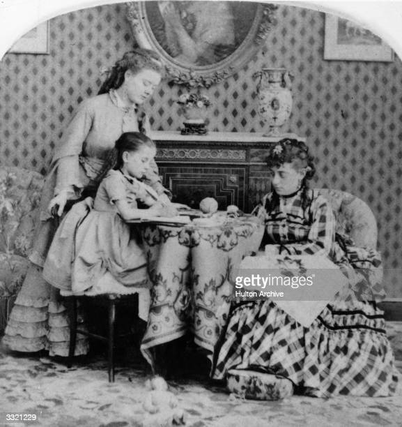The women in a family relaxing with their embroidery and letter writing