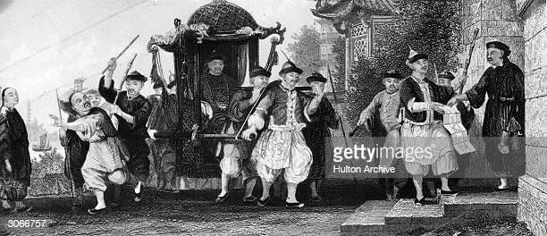 A Chinese mandarin being carried in a sedan chair