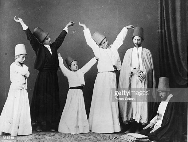A group of dervishes begin their dance known as the dance of the Whirling Dervishes One year earlier British troops had massacred 1000 Dervishes in...