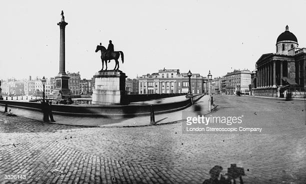 London's Trafalgar Square free of traffic with the National Gallery and Nelson's Column The photographer's shadow can be seen in the foreground