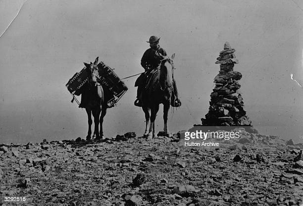 Photographer W H Jackson carrying his photographic equipment on horseback to the summit of Mount Washburn Yellowstone National Park