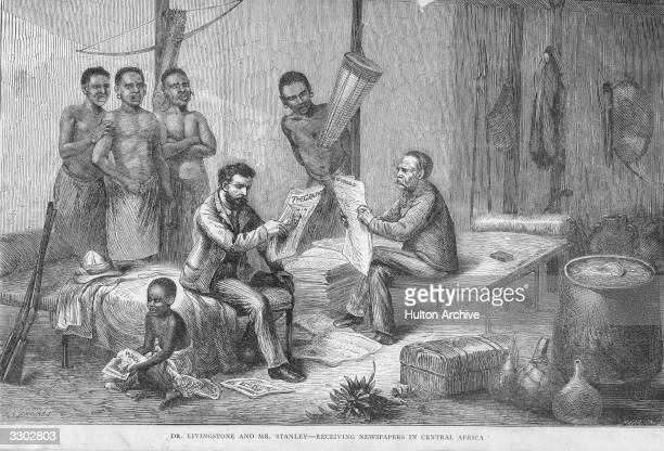 British explorers David Livingstone and Henry Stanley read newspapers while on expedition in Central Africa The Africans watch with curiosity