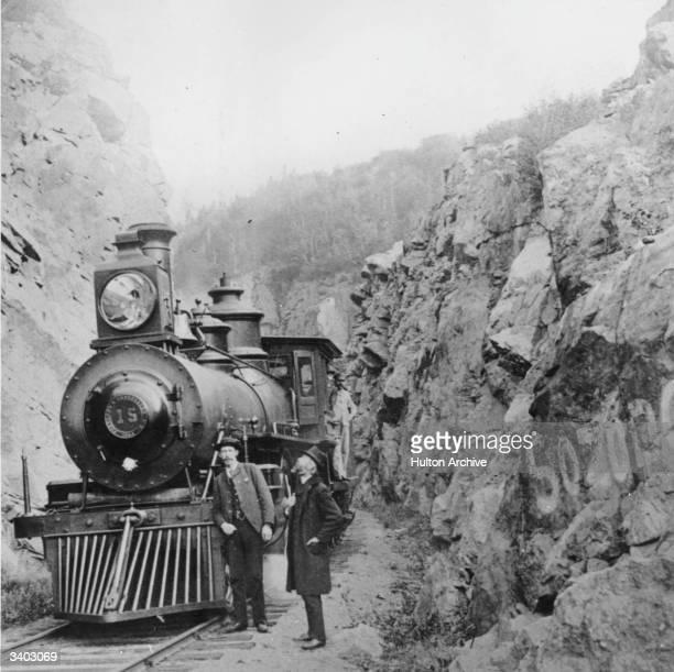 A steam train travelling through the Sierra Nevada hills
