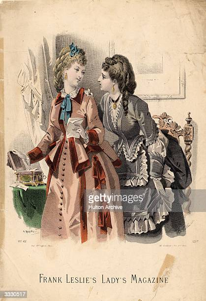 Day dresses with velvet and lace trimmings worn with ornate hairstyle of ringlets and curls Frank Leslie's Lady's Magazine