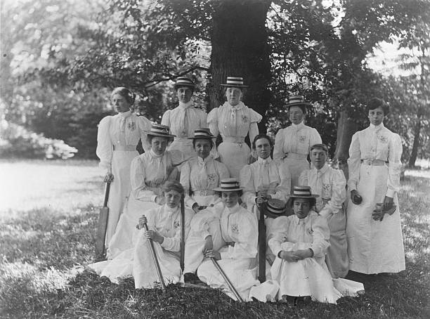 Girls of Holloway College with cricket bats.