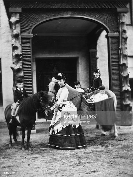 Princess Alexandra consort of the future King Edward VII taking four of her children for a pony ride