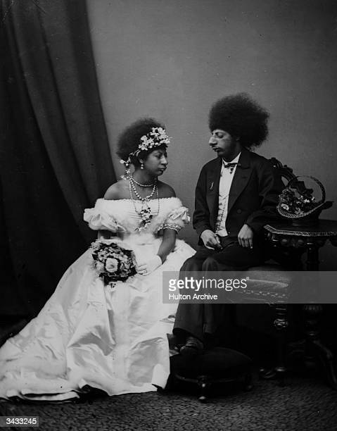 A man and woman from the ancient Aztec tribe of southern and central Mexico dressed in westernstyle wedding clothes The Aztec empire flourished in...
