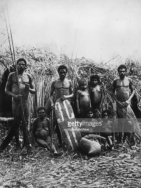Australian Aborigines with decorated shields and spears
