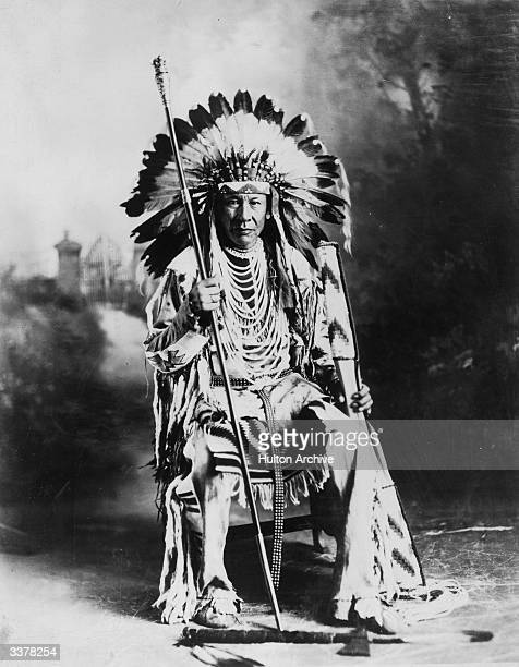 Chief Duck of the Native American Blackfoot tribe in council dress