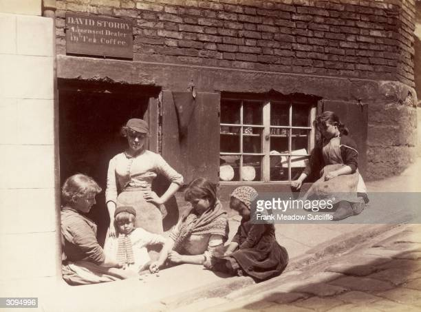 Children playing outside a shop at the foot of the church steps in Whitby