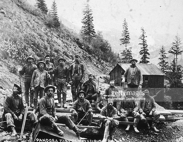 Fulllength group portrait of miners during the Gold Rush at Pandora Mine Telluride Colorado