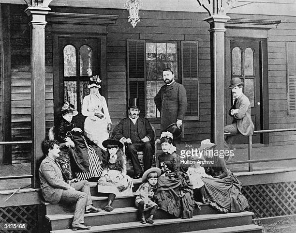 Ulysses Simpson Grant centre American soldier and 18th President of the United States with his family on the verandah of their house