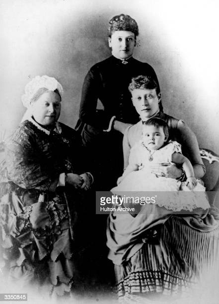 Queen Victoria with Beatrice Princess Henry of Battenberg and Victoria Princess Louis holding Princess Alice
