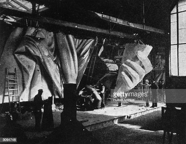 The left hand of the Statue of Liberty under construction Sixty men have worked for almost ten years on the various parts of the statue not including...
