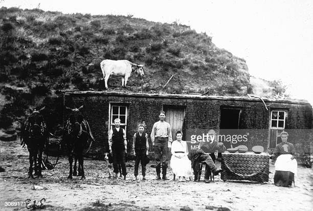 A family outside their sod home out on the Great Plains