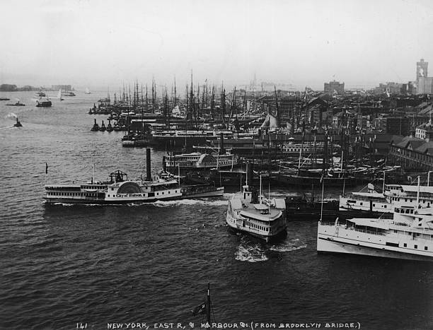 A view of ships, ferries and barges in the East River...