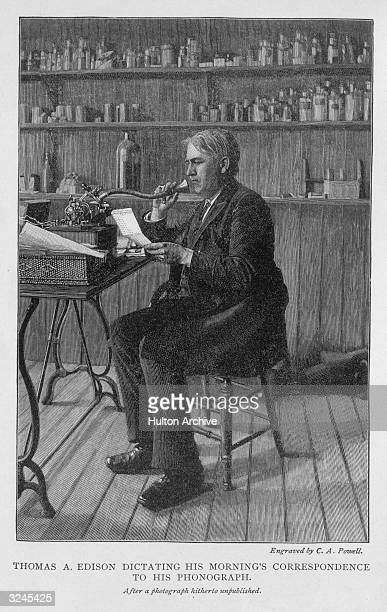 American inventor Thomas Alva Edison dictating his morning's correspondence into a phonograph in his lab. Engraving by C.A. Powell, after an original...