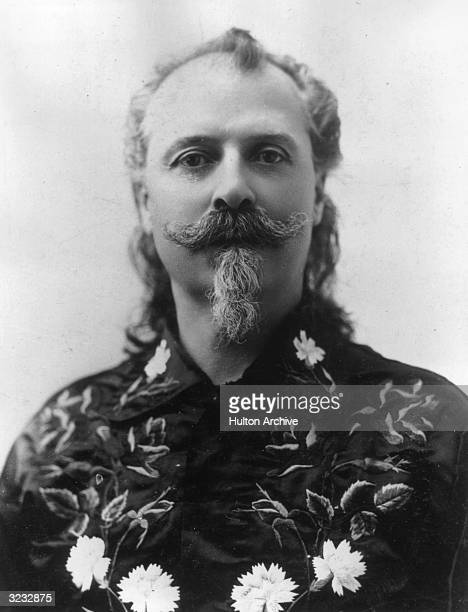 Headshot portrait of American showman army scout and Pony Express rider William F Cody aka 'Buffalo Bill' wearing an embroidered shirt He founded...