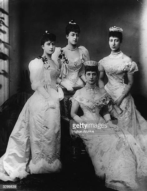 Queen Alexandra with her three daughters Louise, Princess Royal, , Victoria and Maud.