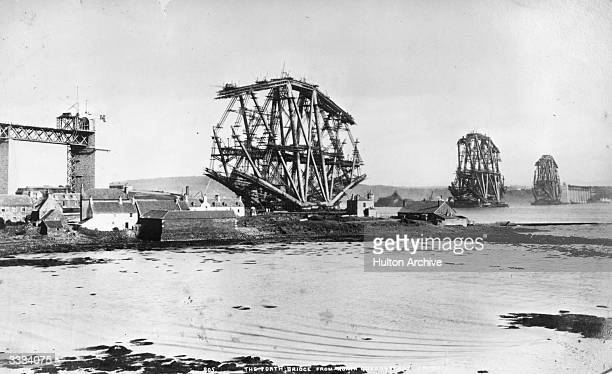 The Forth Bridge under construction seen from North Queensferry The steel cantilever construction was designed by John Fowler and Benjamin Baker to...