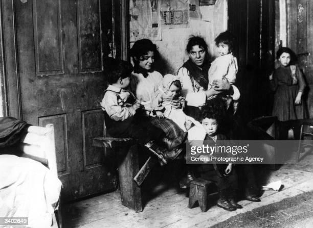 Family in a tenement slum in New York.