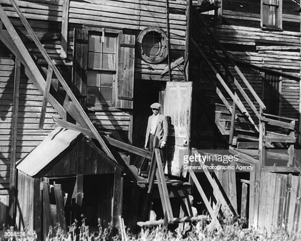 Back door in a tumbledown wooden slum house Chicago